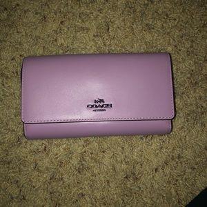 purple coach wallet/crossbody